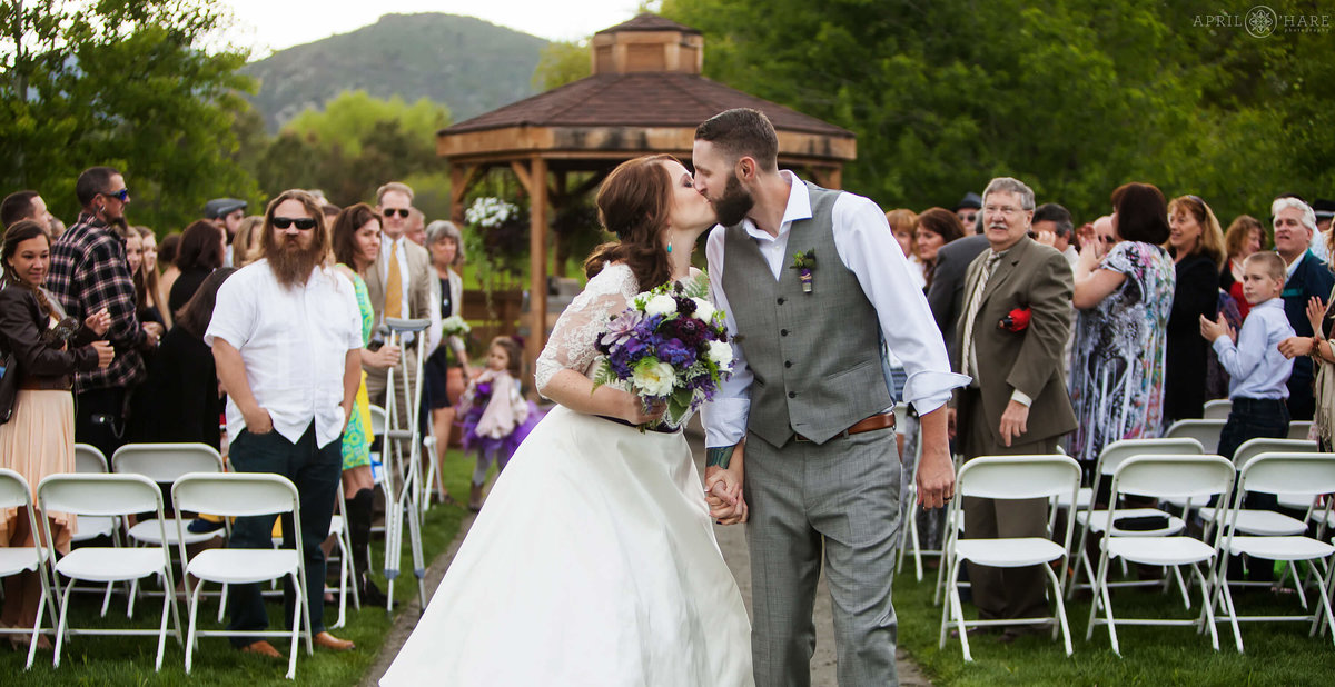 Kissing at end of the aisle at Denver Botanic Gardens Chatfield Farms in Colorado
