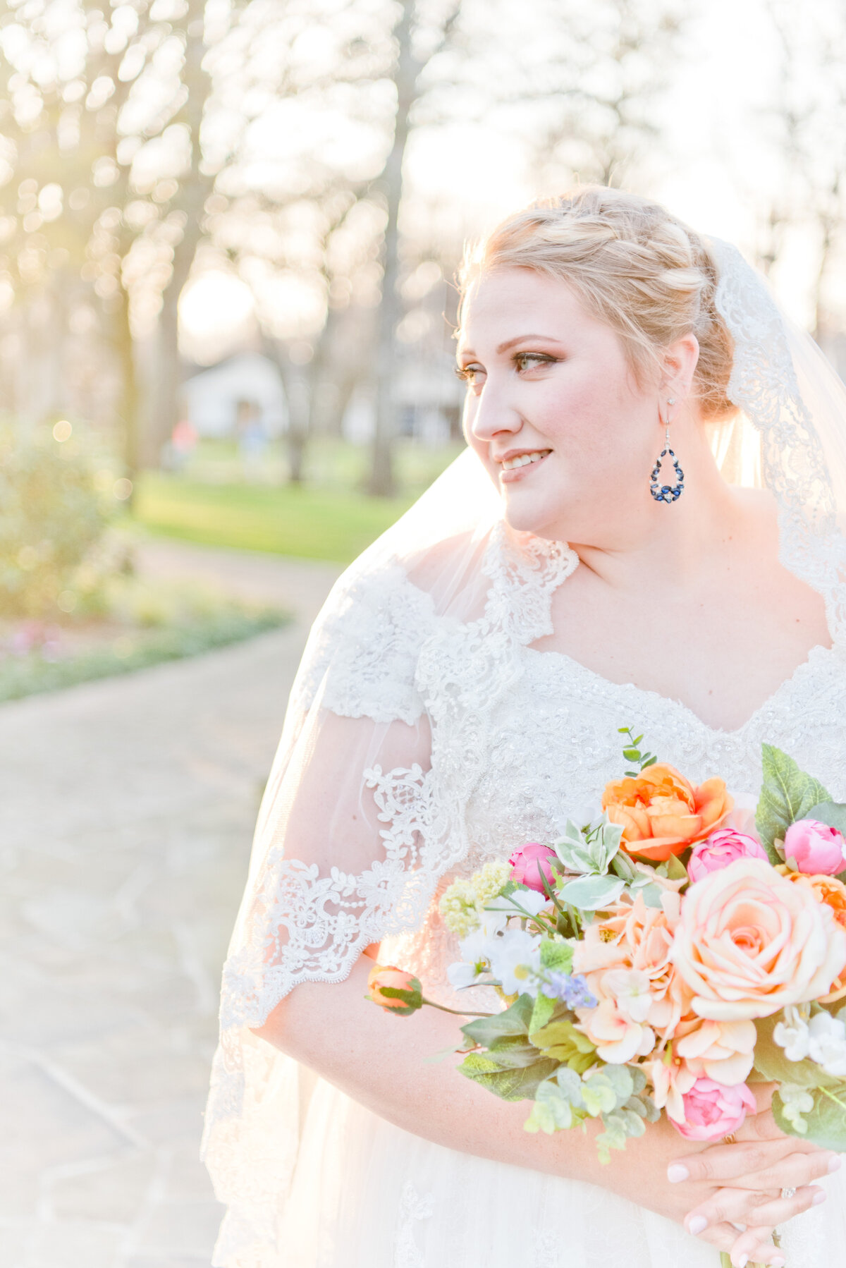 Bride looking into Fort Worth sunset while holding colorful vibrant bouquet