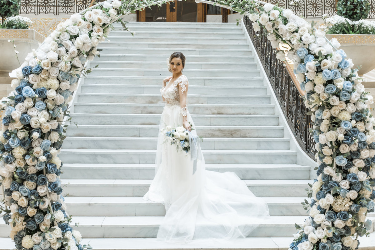 bride with flower arch at the rookery building