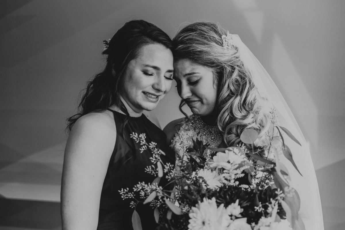 A bride and her sister share an emotional Moment before the wedding