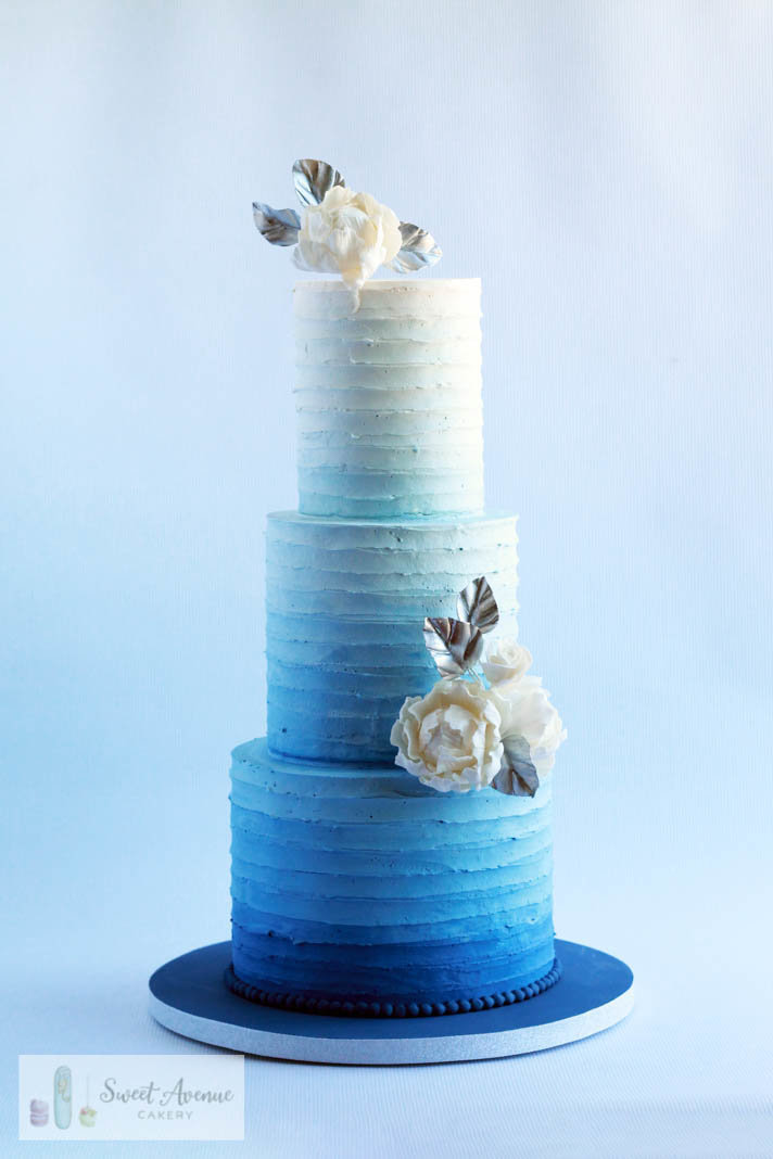 striped blue ombre buttercream wedding cake with white and silver flowers, Hamilton ON wedding cakes