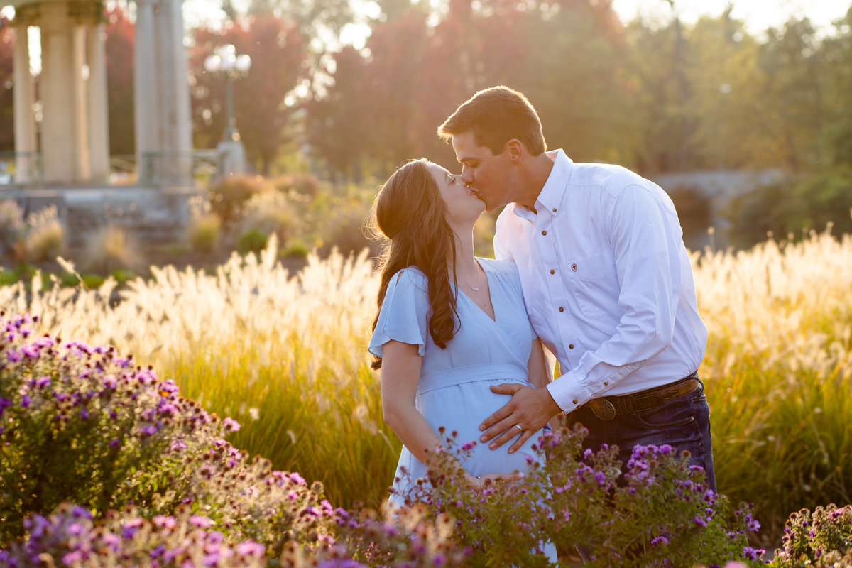 Fall Sunset Maternity Session with blue maxi dress with purple flowers and tall grass at Pagoda Circle in Forest Park in St. Louis by Amy Britton Photography Photographer  in St. Louis