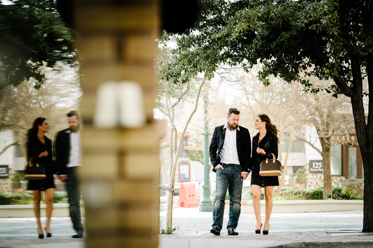 couple walking  during their el paso engagement session