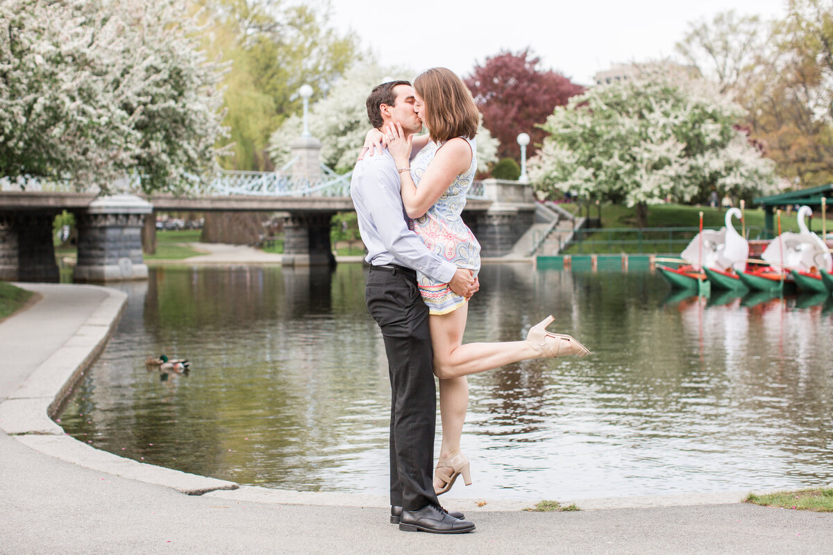 couple kissing in Boston Public Garden in Spring