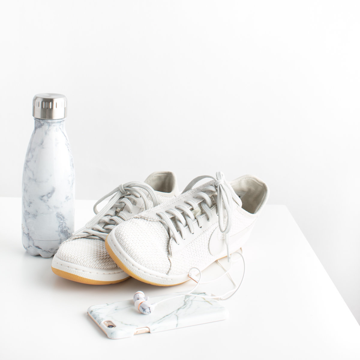 white shoes water bottle