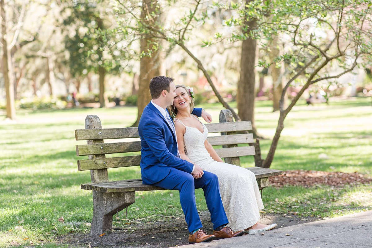 bride and groom on bench in forsyth park