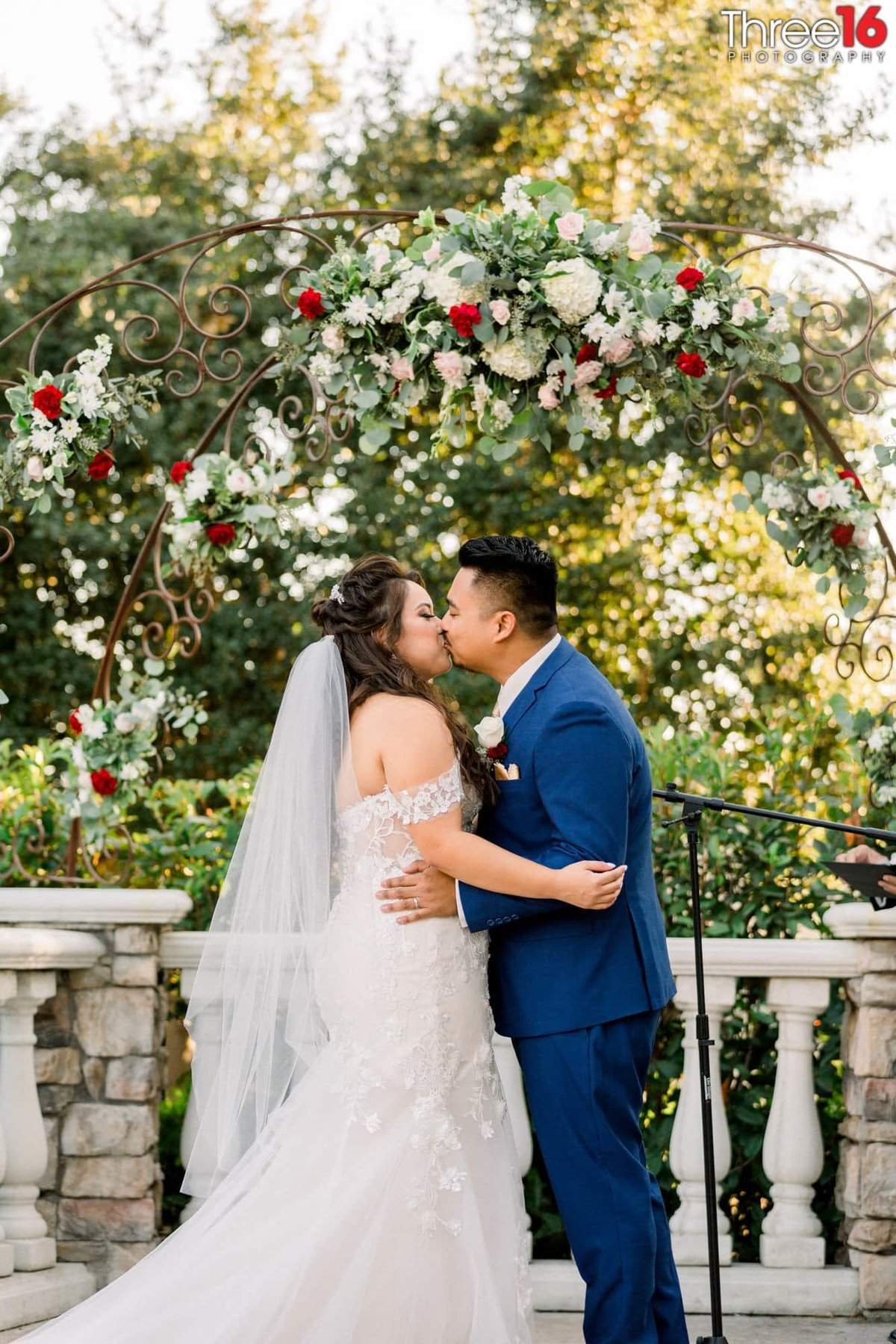 Groom kisses his Bride to seal the marriage