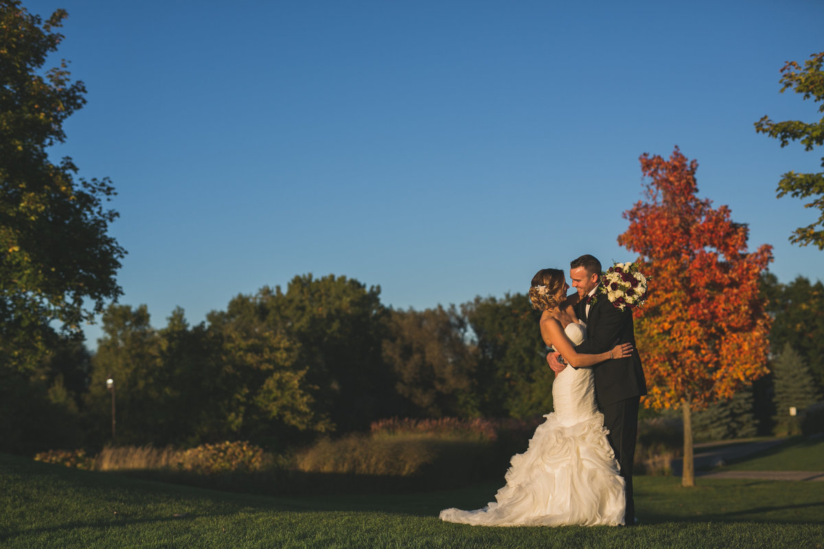 Bride and Groom golden hour scenic fall colors Twin Lakes Golf and Swim club, Oakland, Michigan, wedding photographer Charlene Gurney