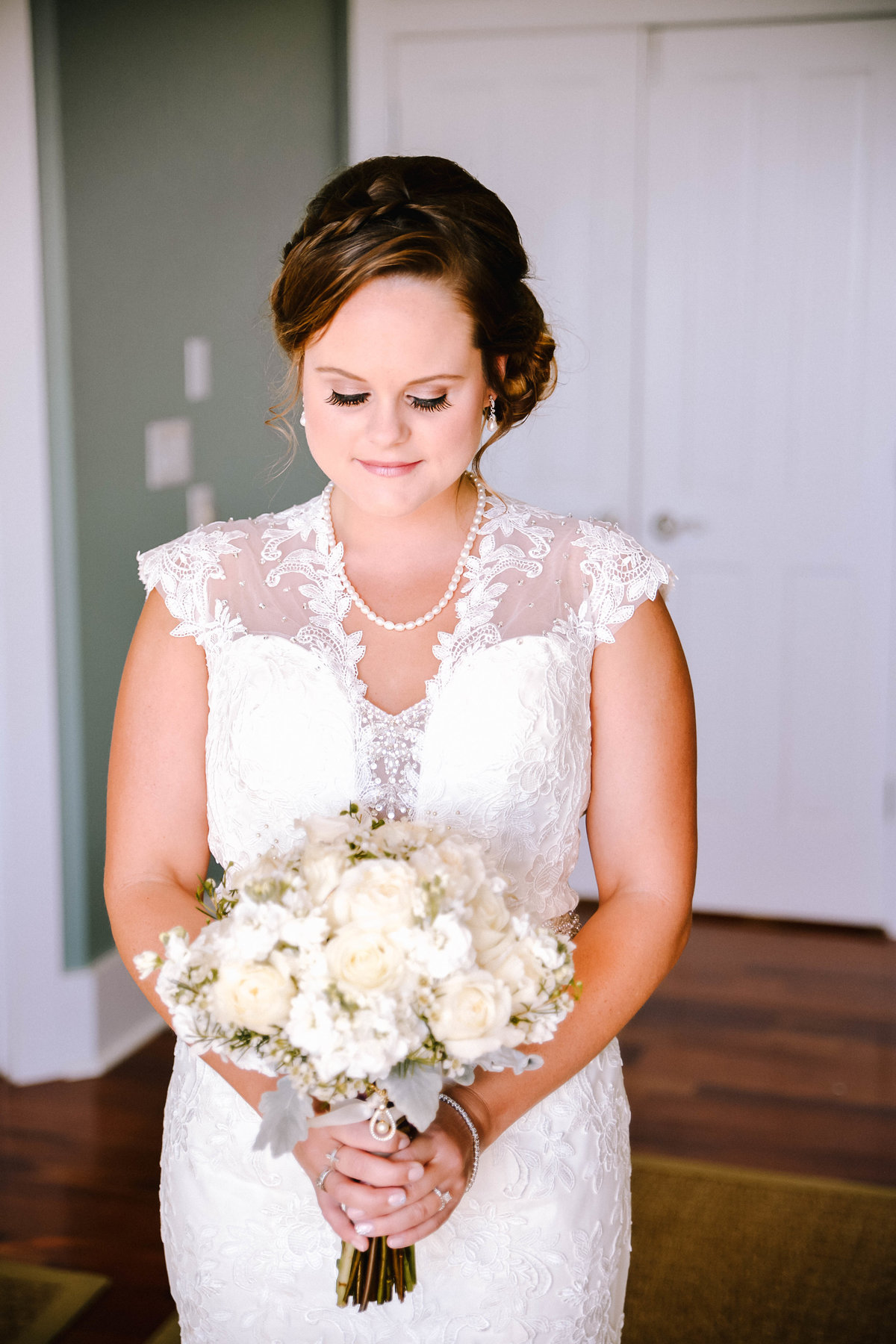 Bride holding her bouquet at a beach house in Destin, FL