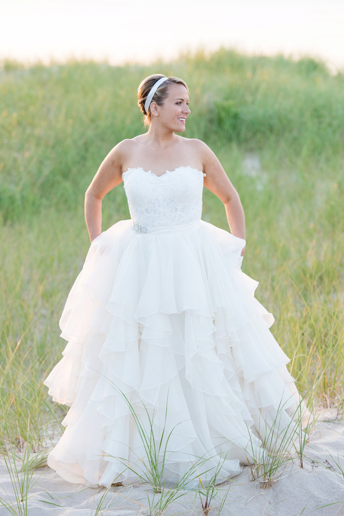 photo of bride walking on the beach from wedding at Pavilion at Sunken Meadow
