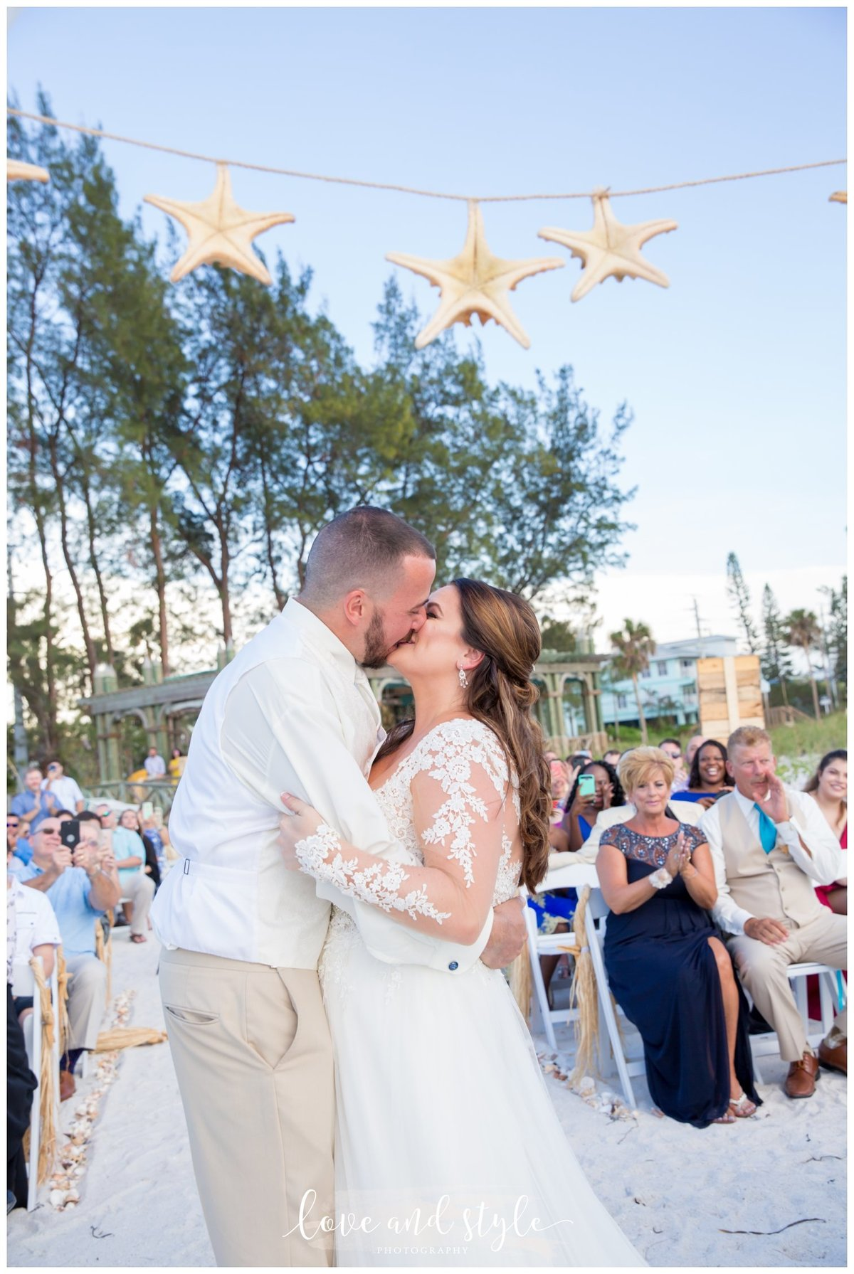 Anna Maria Island wedding photography ceremony with bride and groom kissing