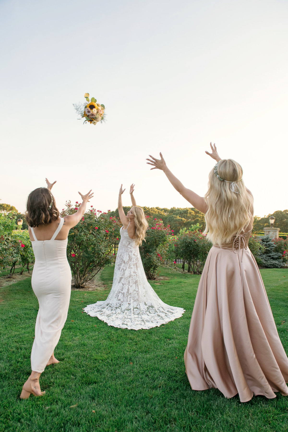 bride tossing bouquet outside Giorgios Baiting Hollow