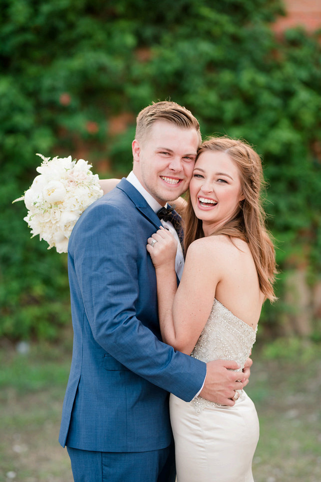 Bride and Groom smiling happily by Dallas photographer