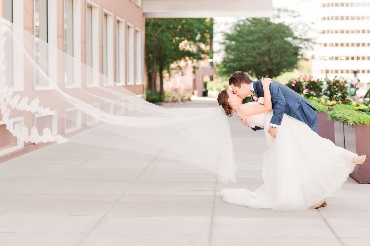 Bride and groom kissing at University Club in Denver, Colorado.