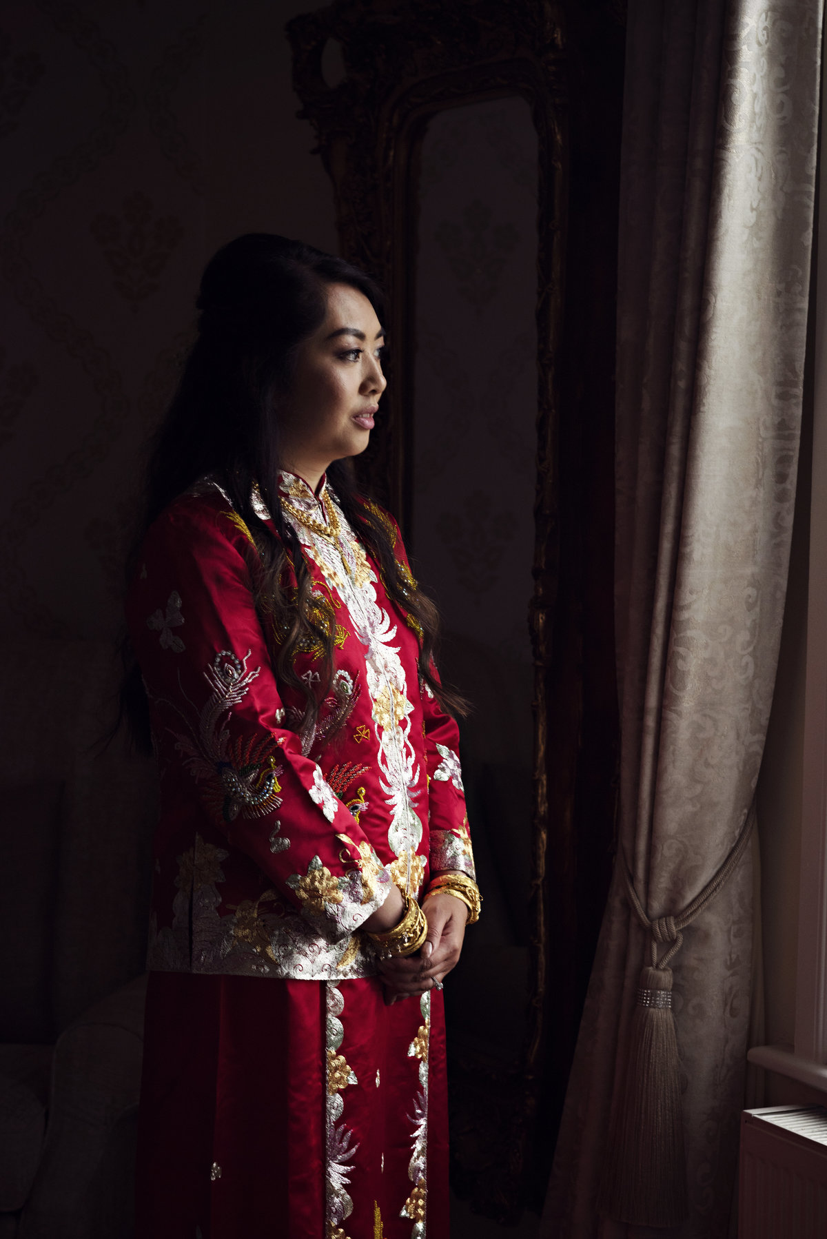 A bride in traditional Chinese Dress