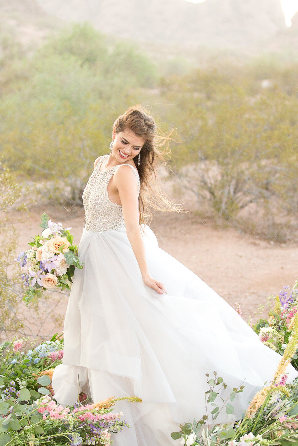 bridal portrait in desert wearing blush by Haley gown