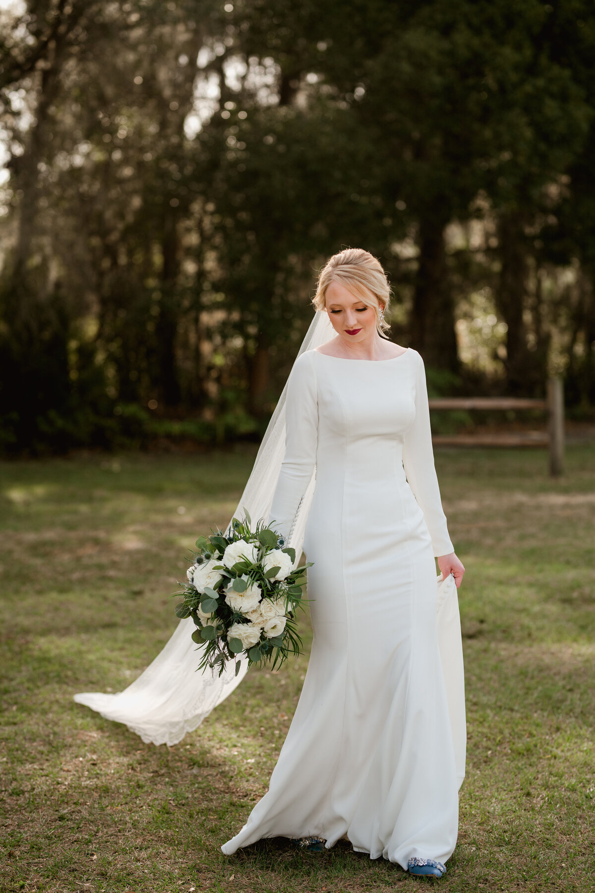 Beautiful bride in elegant gown taken by professional wedding photographer in Gainesville, Florida