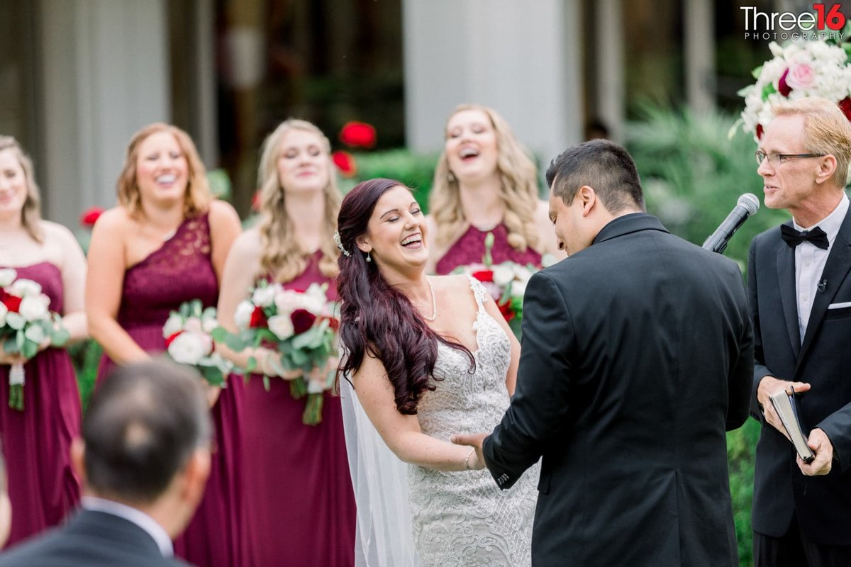 Bride and Bridesmaid start laughing during the ceremony