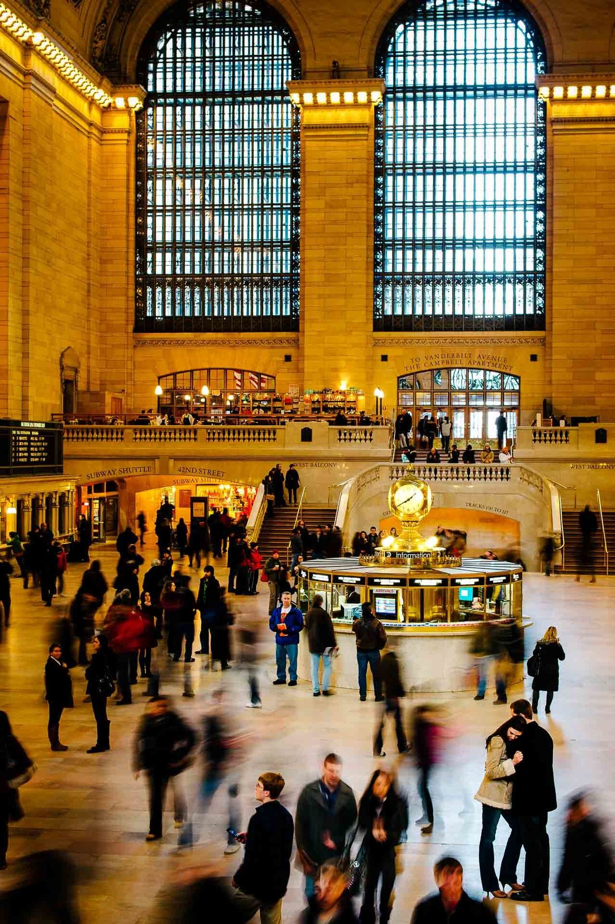 engagement photo at grand central station in nyc by stephane lemaire photography