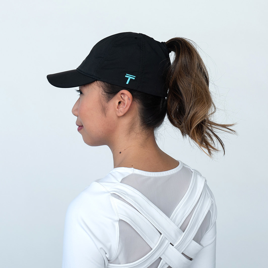 women in side profile with a baseball cap