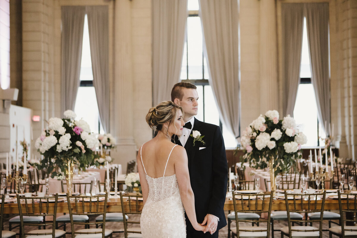 Bride and groom embracing in wedding reception room in Buffalo, New York