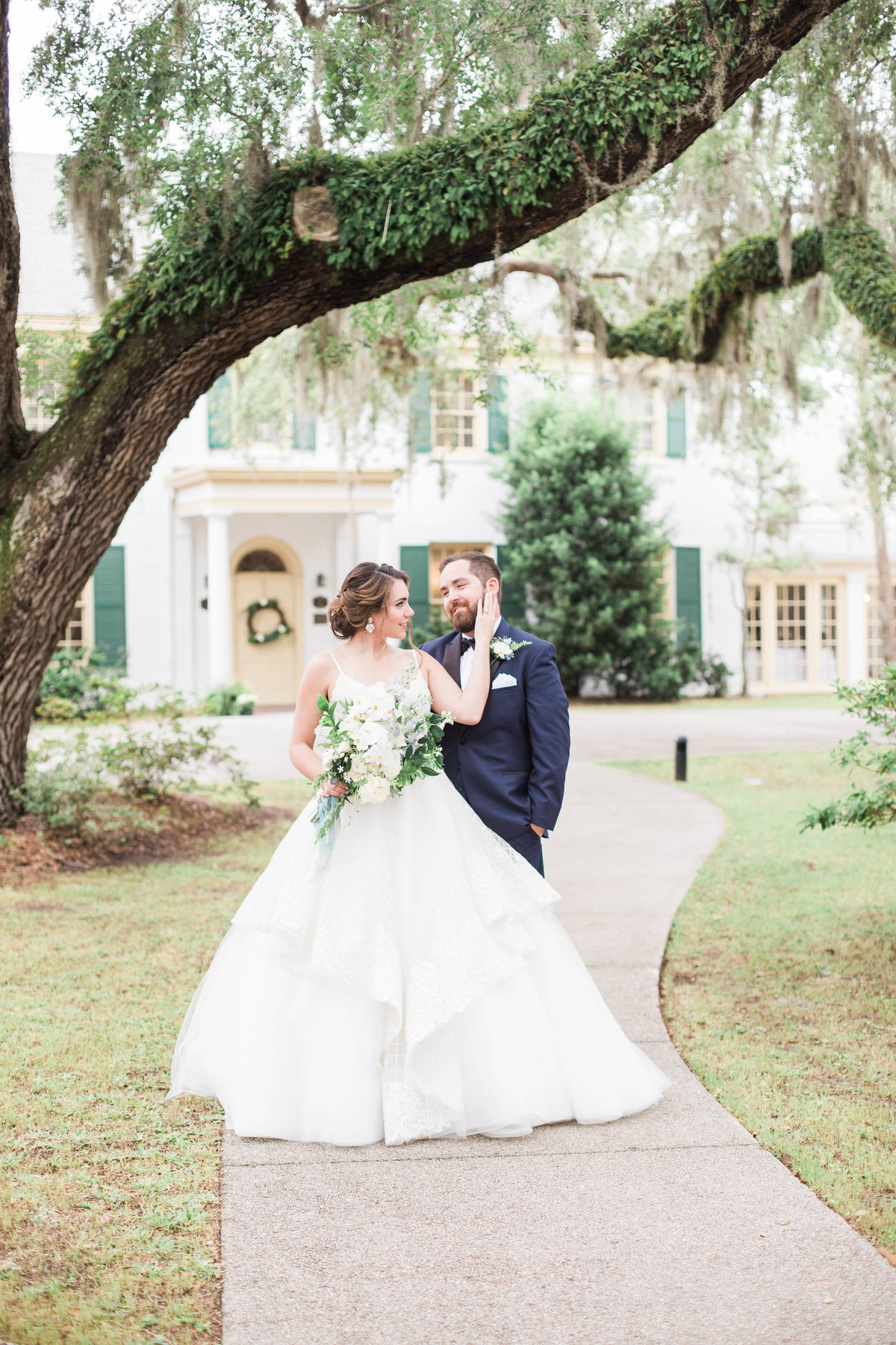 Bride and Groom in front of Ribault Club during Jacksonville Wedding