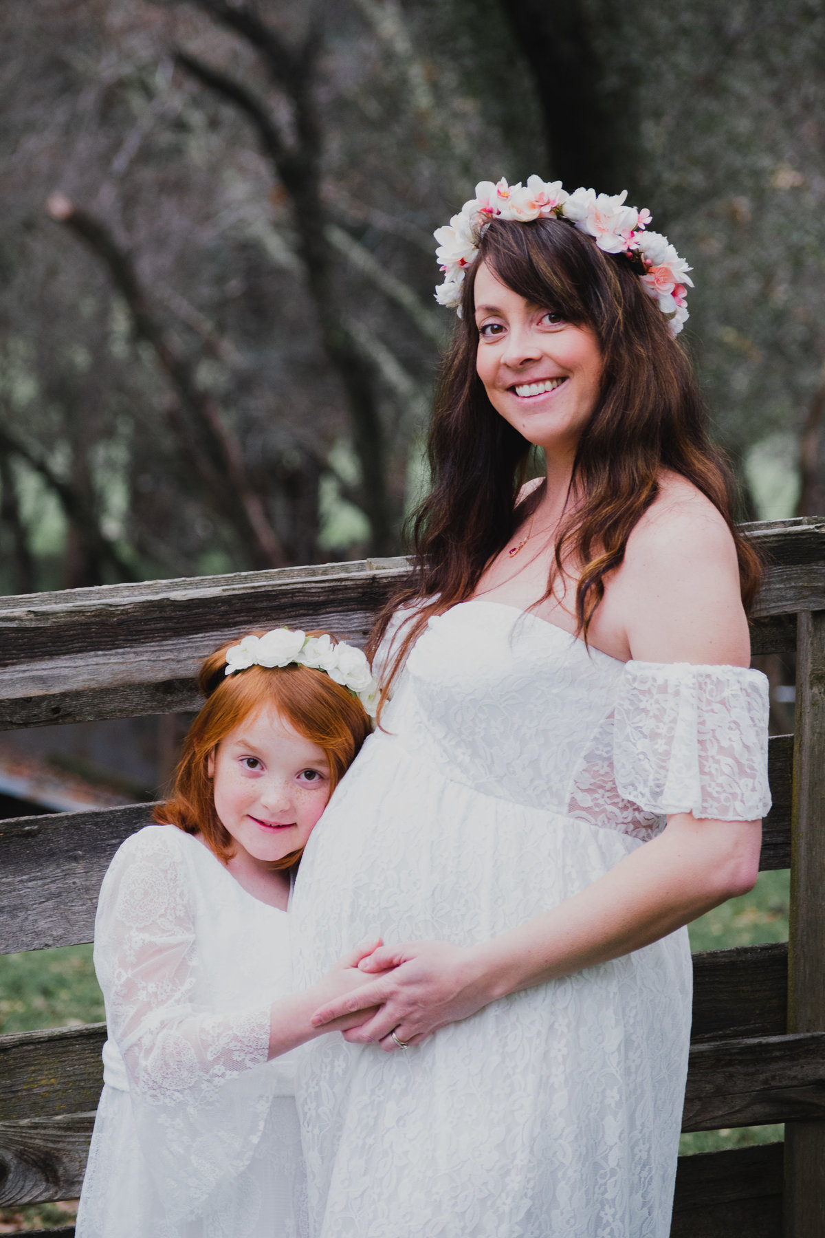 pregnant mom and daughter with flower crowns