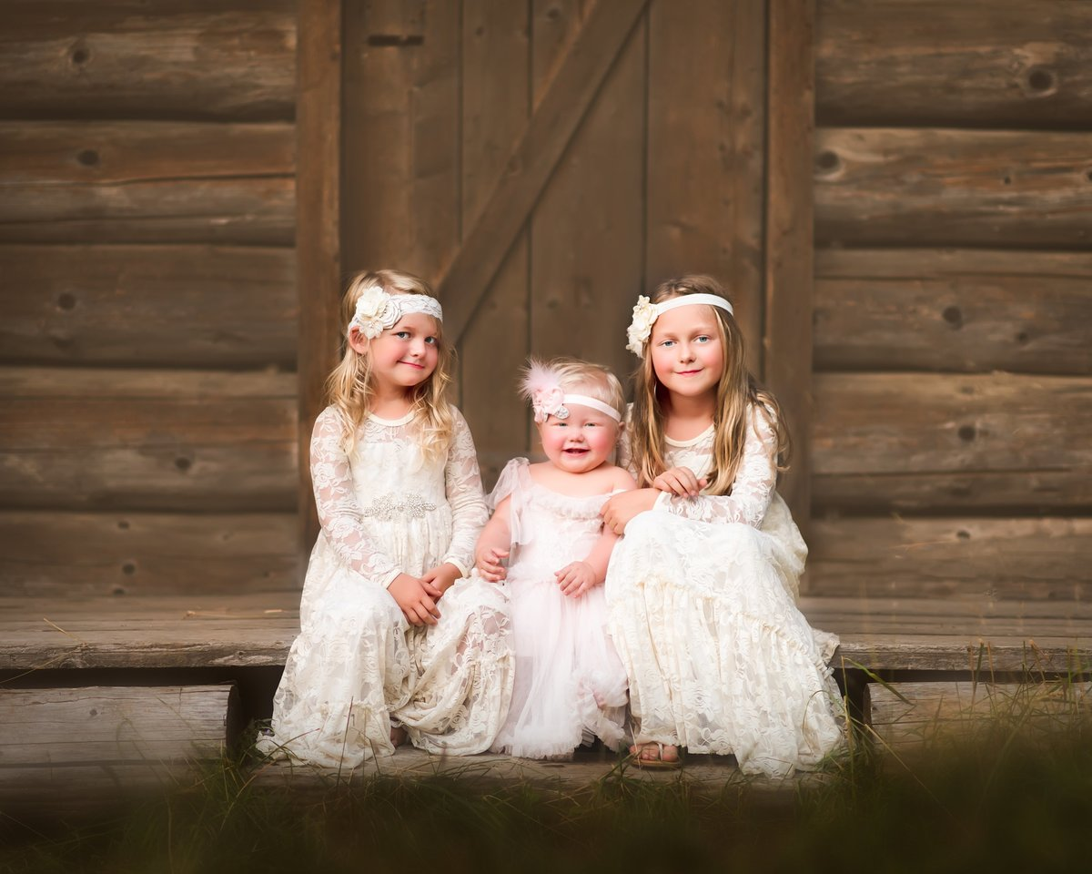 Portrait of three girls in dresses by Cle Elum Family Photographer