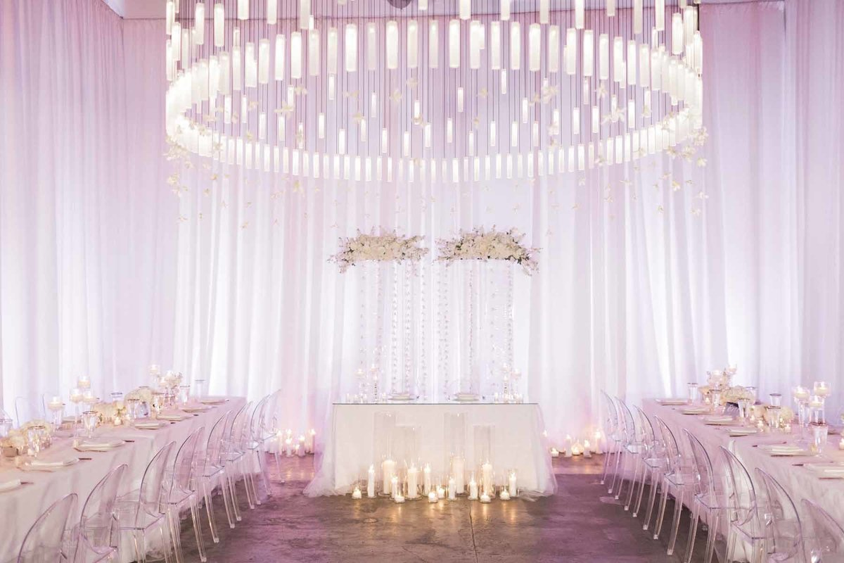 What a romantic all white reception Flora Nova Design created for this wedding at Canvas Event Space in Seattle