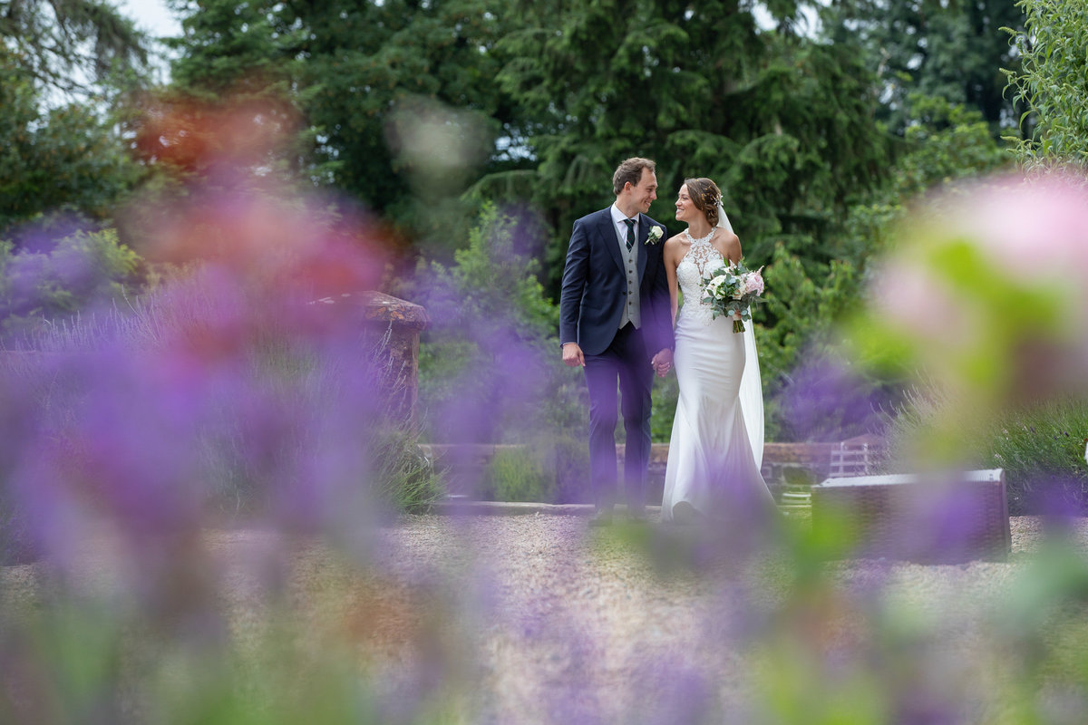 Bride and Groom in the gardens at Huntsham Court Wedding Devon_