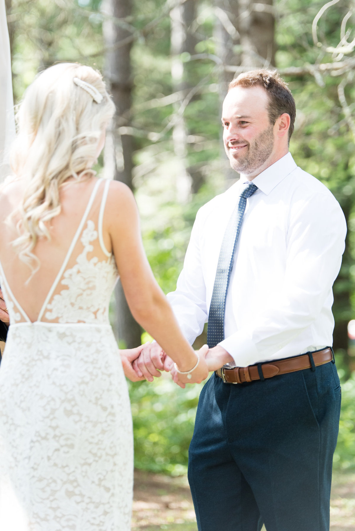 Groom looks lovingly at his bride during their wedding ceremony at Stepstone Centre in Thunder Bay