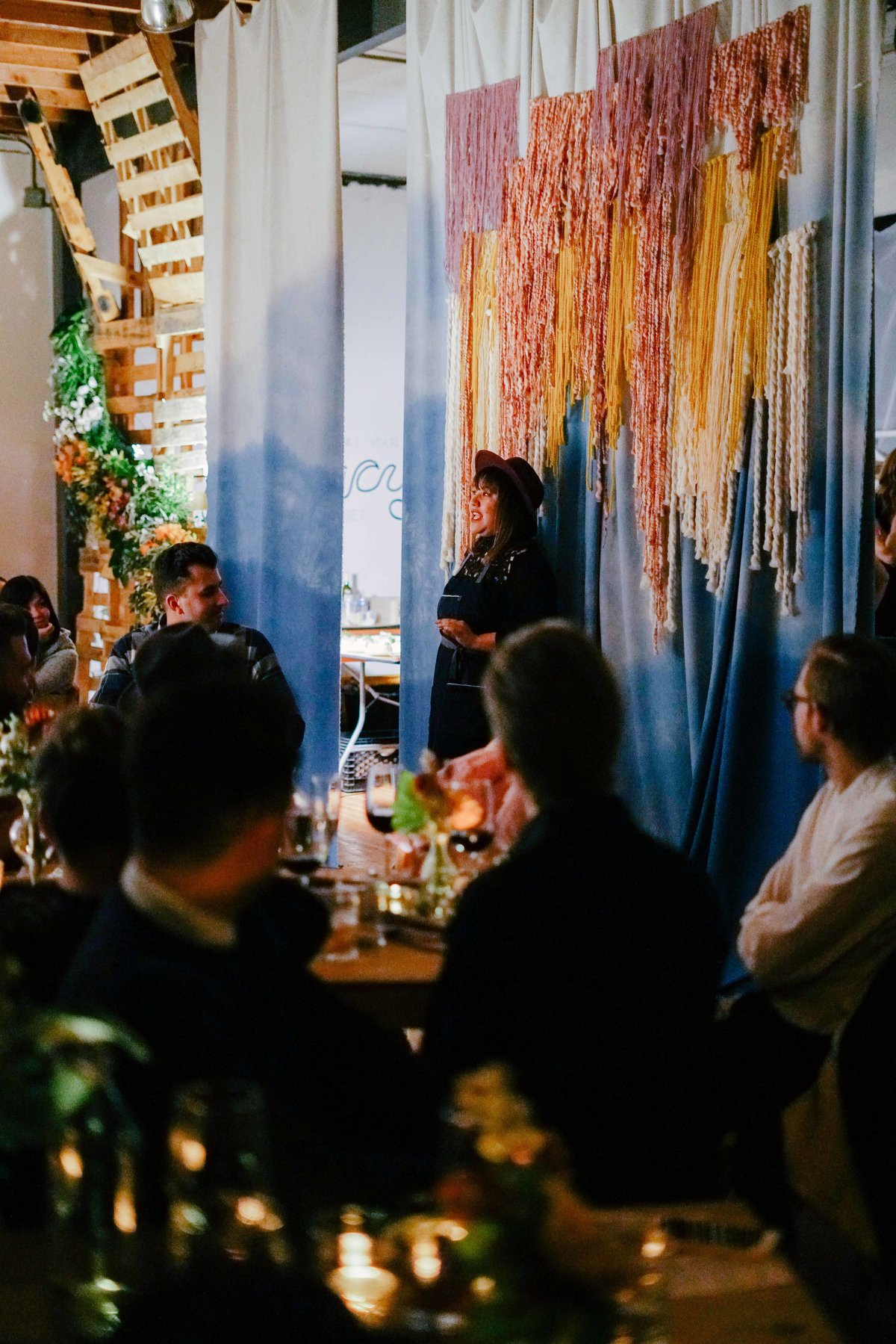 Dinner party with colorful string background