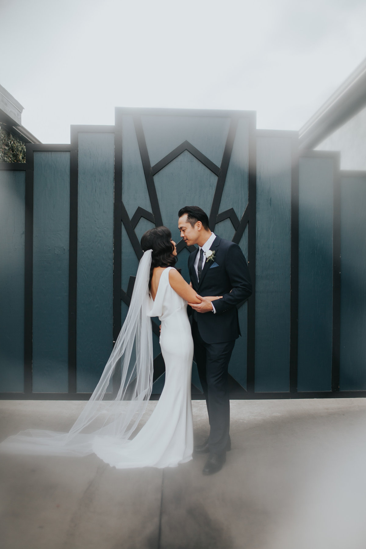 Modern bride and groom first look at The Fig House wedding