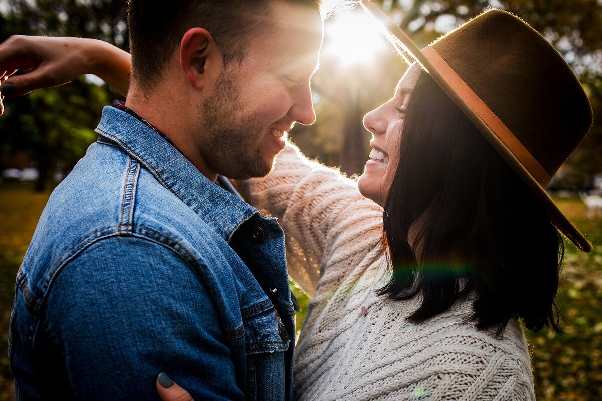 A couple hugs in a ray of sunlight during a Logan Square engagement session.
