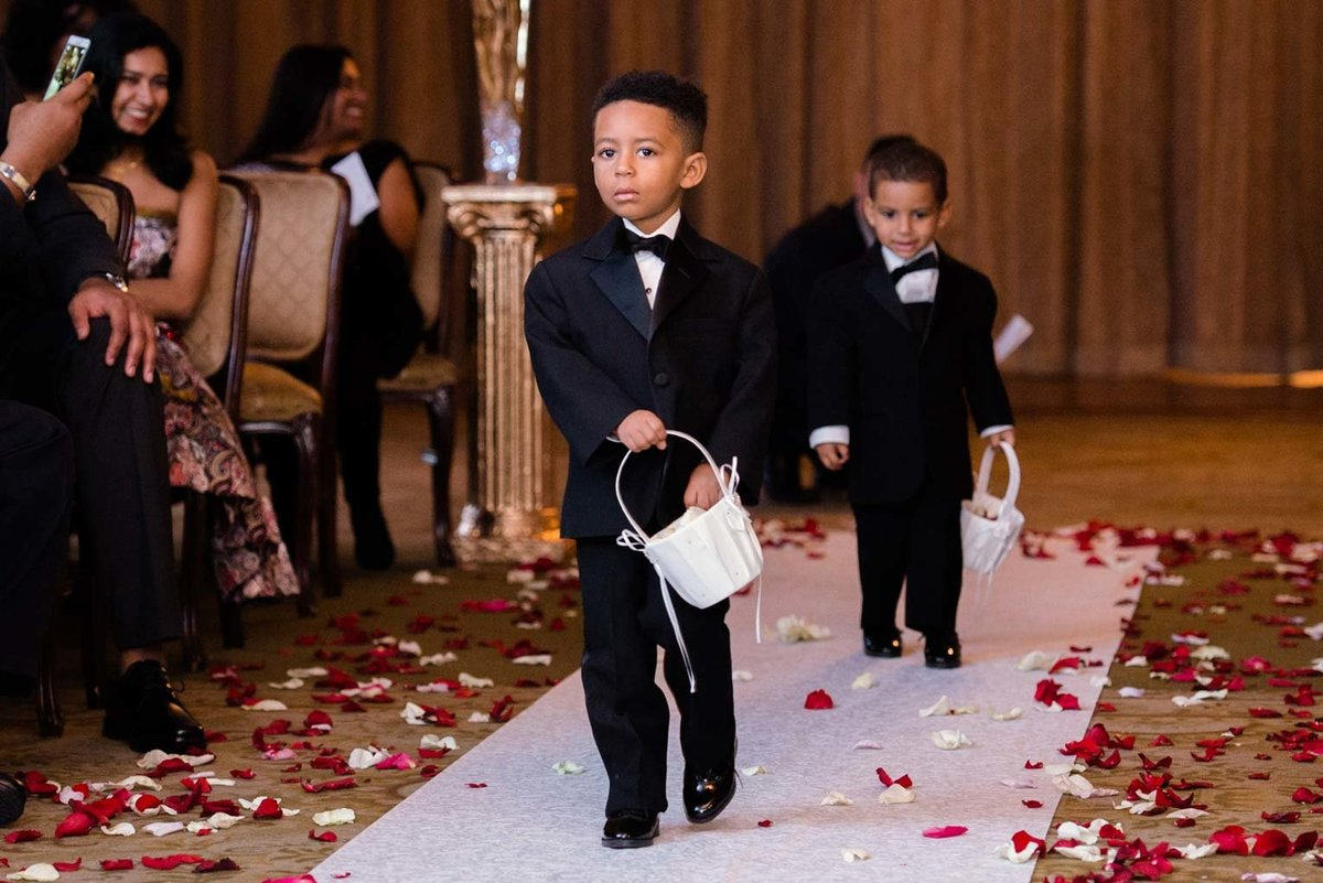 Ring bearers walking down the aisle at The Mansion at Oyster Bay