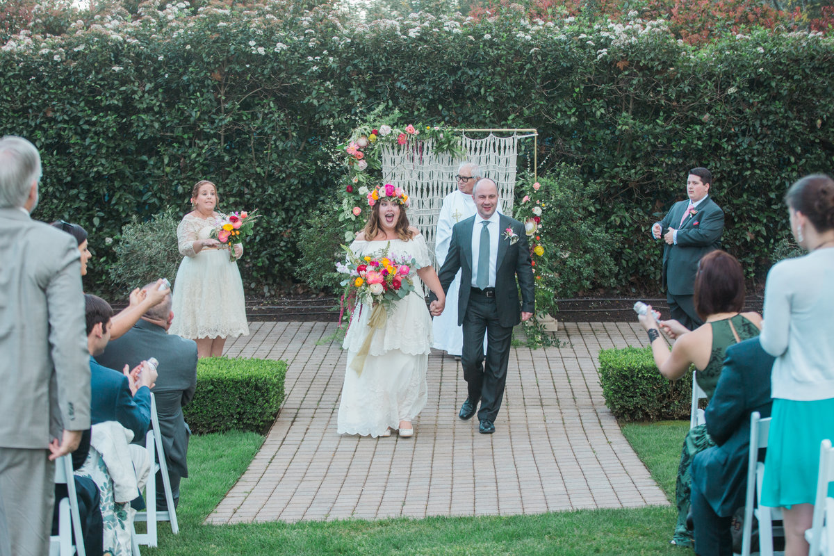 Bride and groom walking away after ceremony at Madrona Manor in Healdsburg California