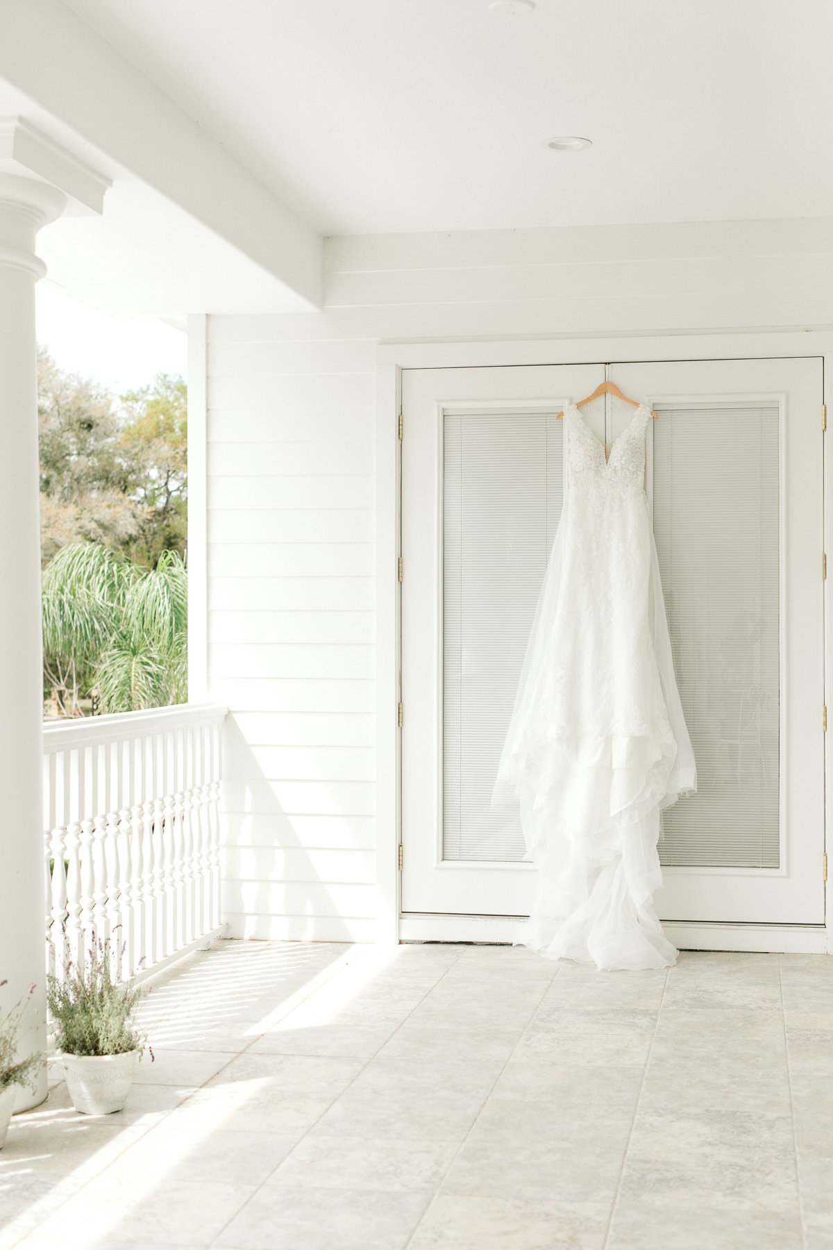 wedding dress hanging on balcony