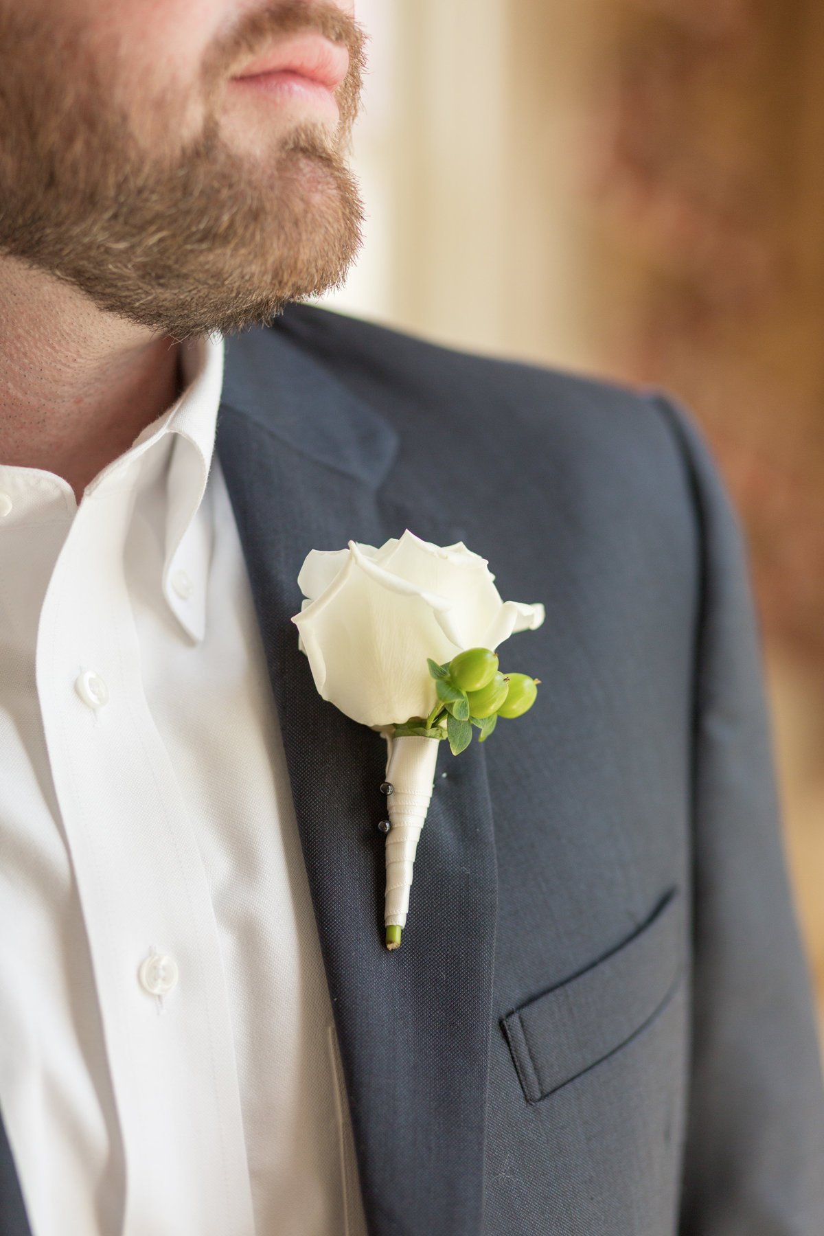 close up of grooms flowers