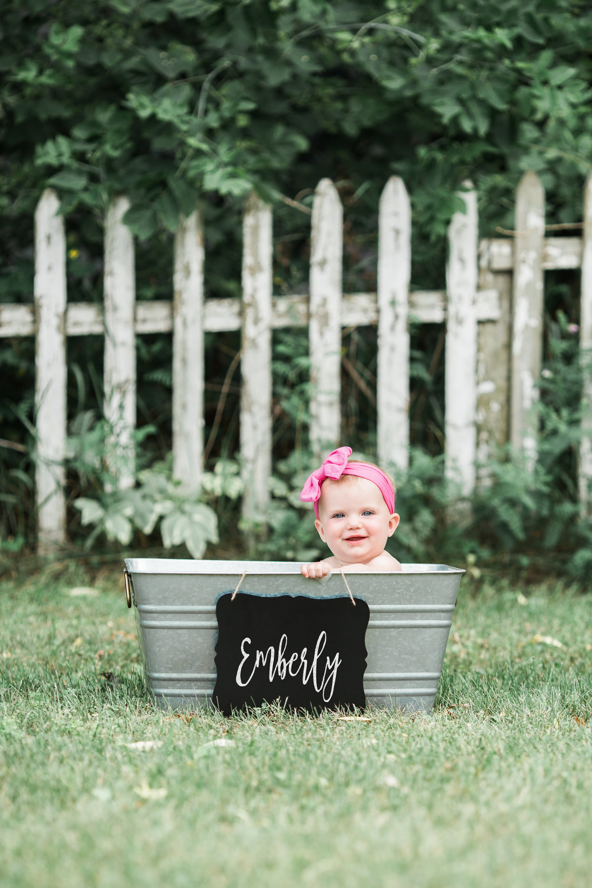 First birthday photo of a little girl in a tin tub taken by Jacksonville Family Photographer