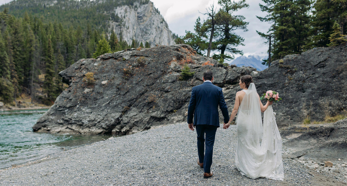 bride groom walking rocks bow falls banff intimate wedding