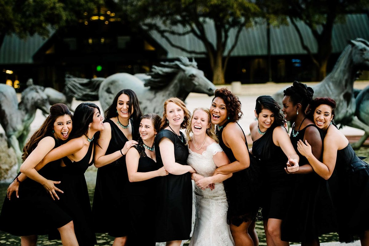 bridesmaids laughing during  wedding at la cima club in dallas texas by stephane lemaire photography