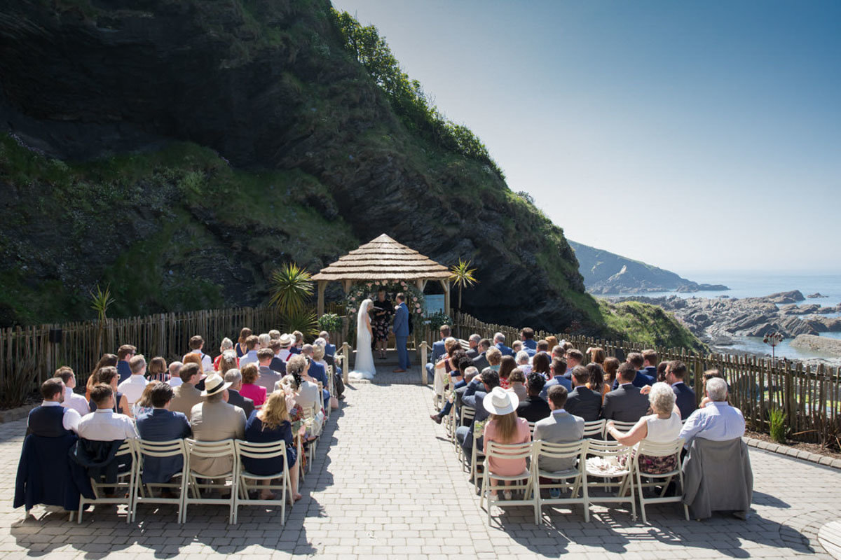 Summer outdoor wedding ceremony at Tunnels Beaches