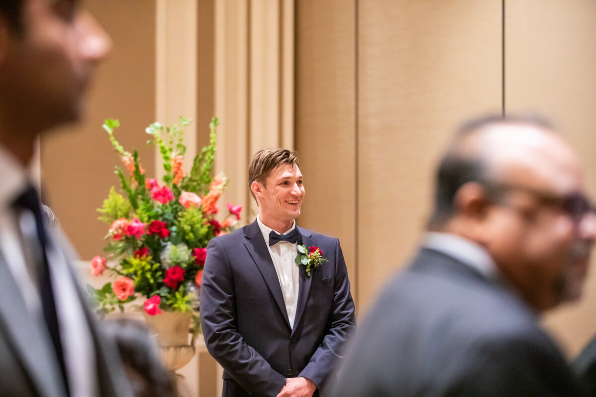 Groom Waits on the Altar in Anticipation