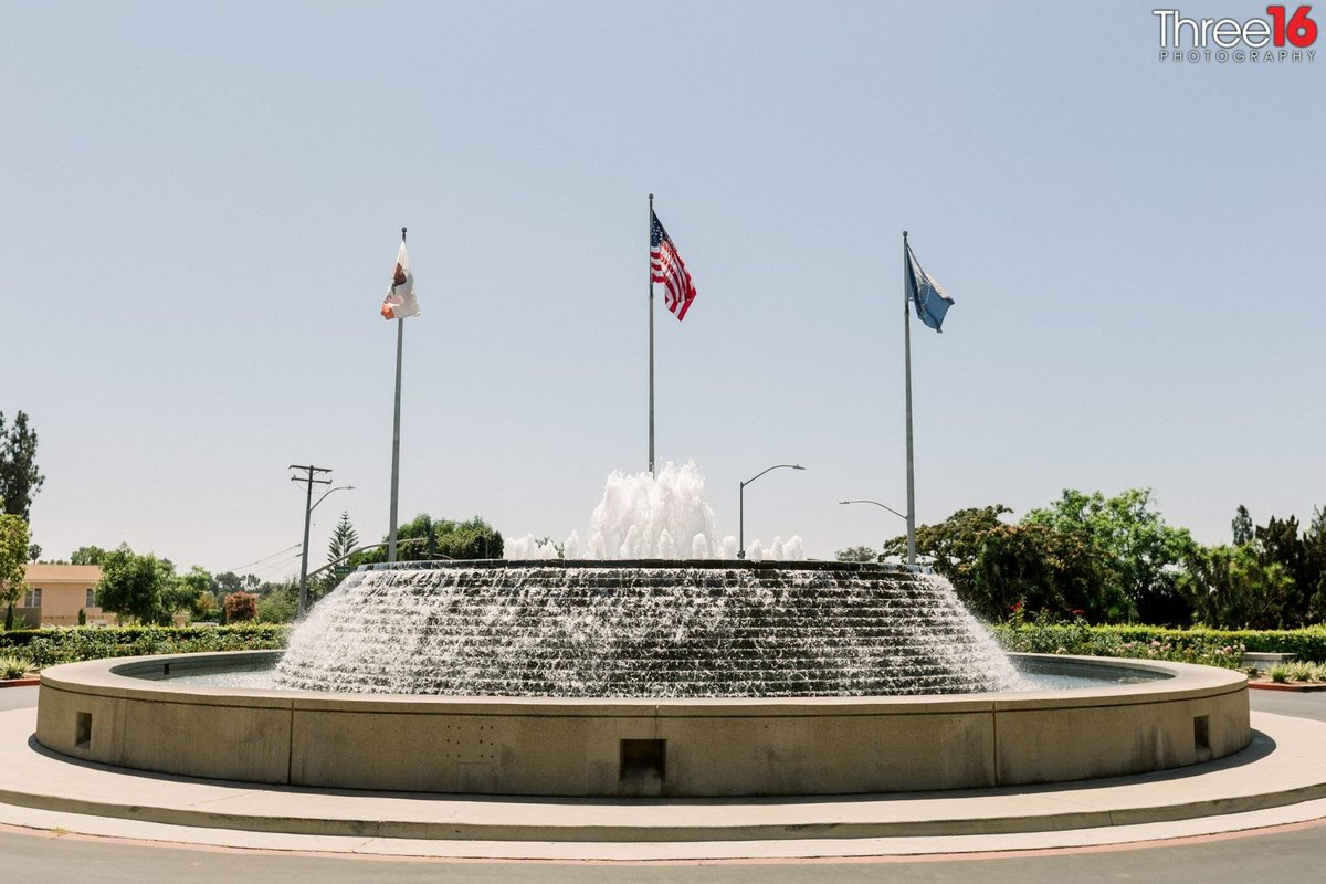 Flags fly high over the water fountain at the Richard Nixon Library