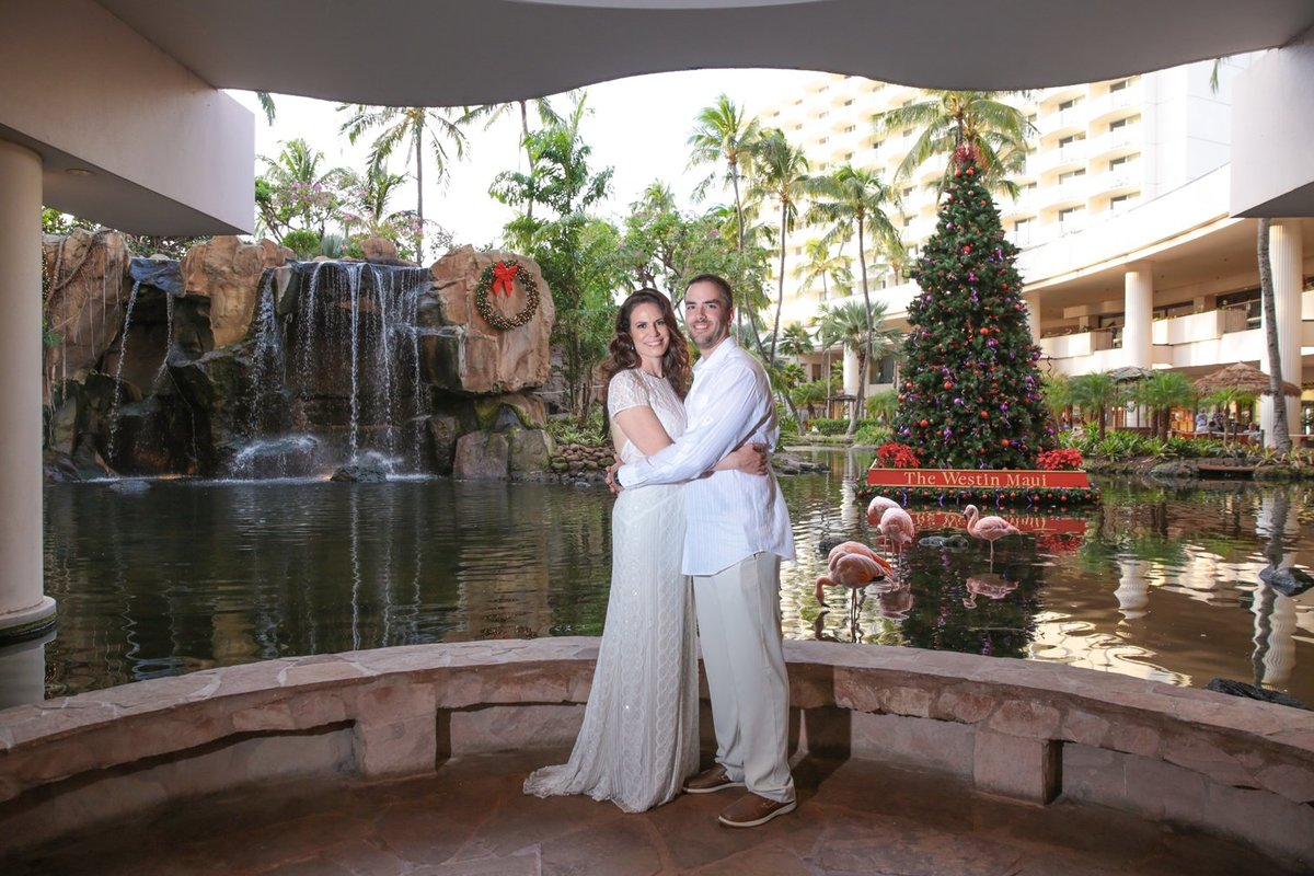 Wedding Photography at The Westin Maui Resort and Spa with bride and groom in the lobby in front of the waterfall