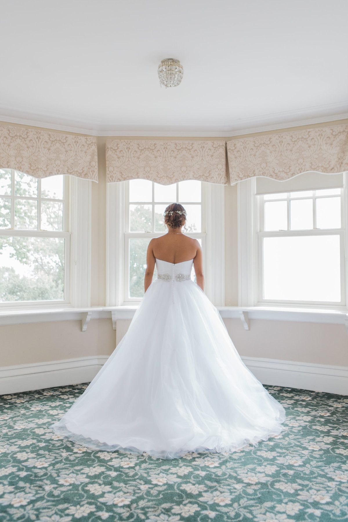 Burlington-wedding-photographer-bride-looking-out-window-at-paletta-mansion