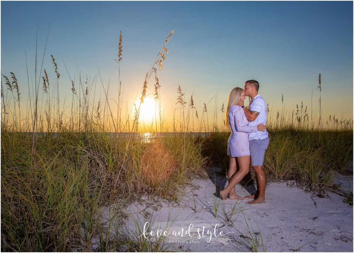 Engagement Photography on Anna Maria Island at Sunset with couple embracing