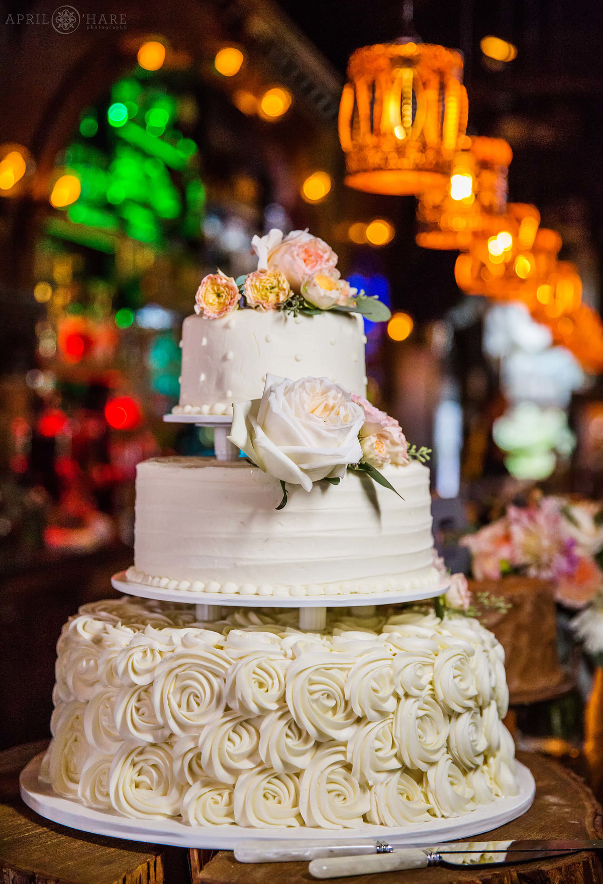Crested Butte Wedding Reception with white wedding cake at Bonez Restaurant in Colorado