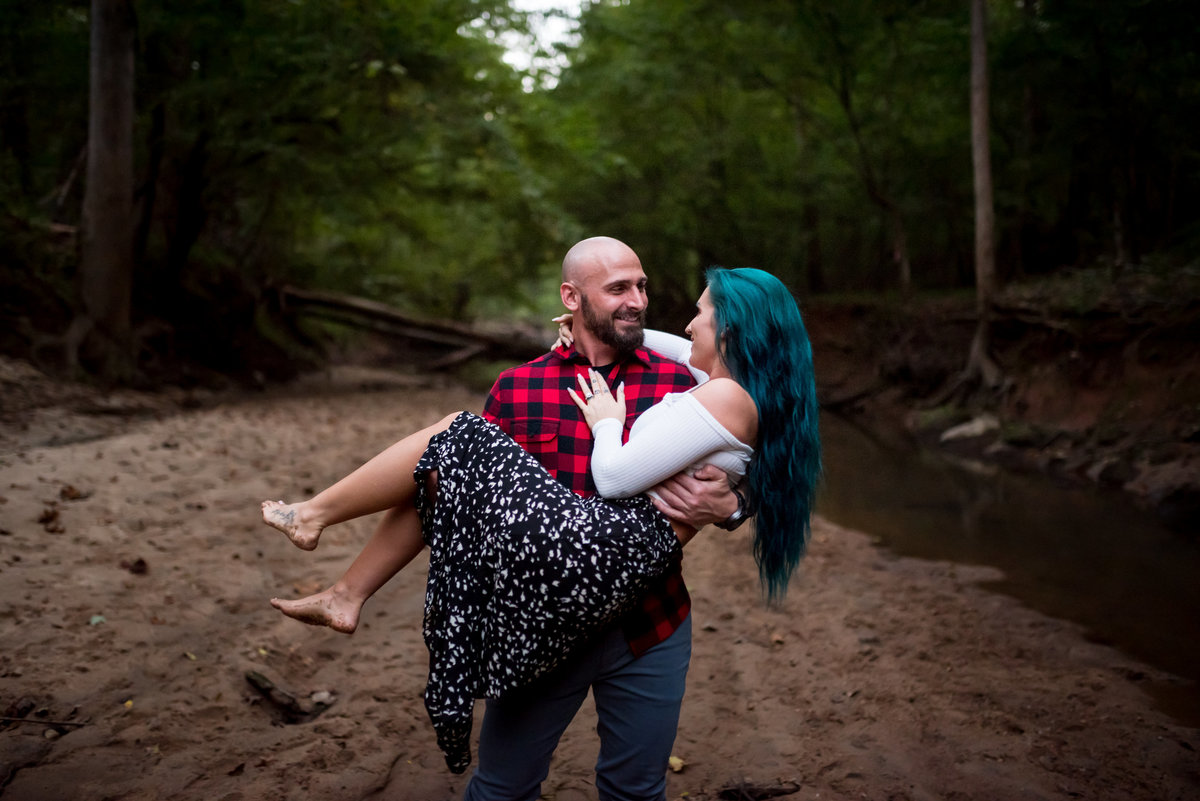 guy-carries-fiance-engagement-photographer