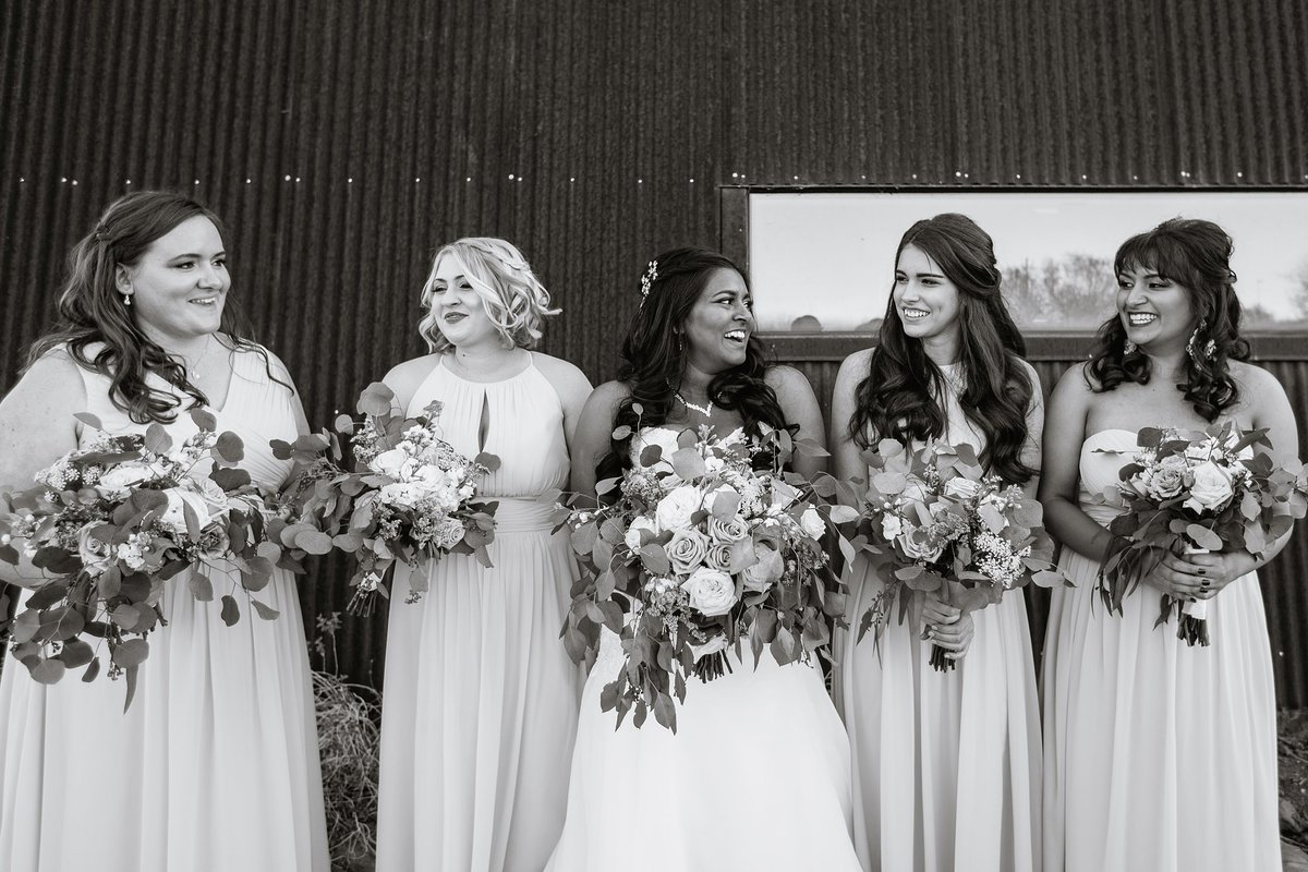 Black and white image of bride with bridesmaids by Phoenix  wedding photographer PMA Photography.